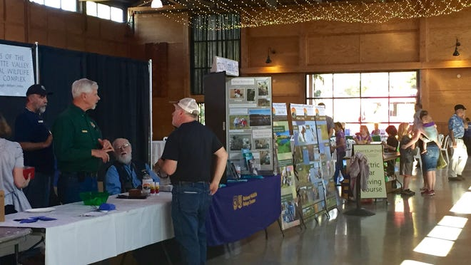 Visitors mill from booth to booth at Saturday's Earth Day fair at The Oregon Garden.