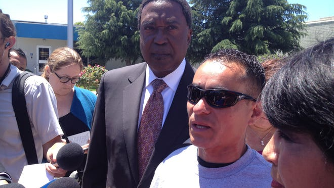 Rogelio Mejia, with attorney John Burris at left, recalls his brother's death and announces a wrongful death claim against the Salinas Police Department.