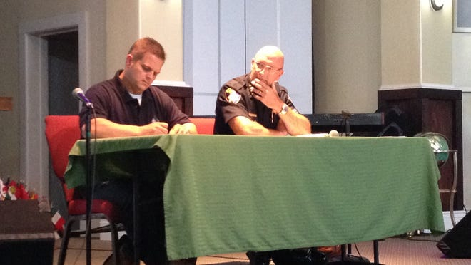 Salinas police Officer Gabe Carvey, president of the Police Officers Association, (left) and Chief Kelly McMillin (right) listen as residents ask questions during a Thursday night Town Hall in east Salinas.