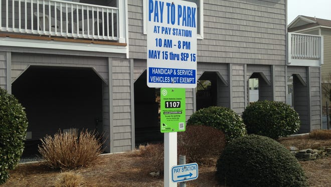 Parkmobile signs, as seen in Bethany Beach, will pop in Dewey Beach in time for the tourist season.