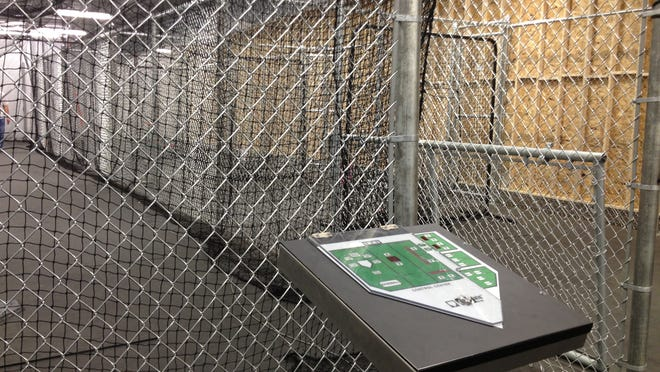 Batting cages at Perfect Practice Sports Academy include some high tech features.