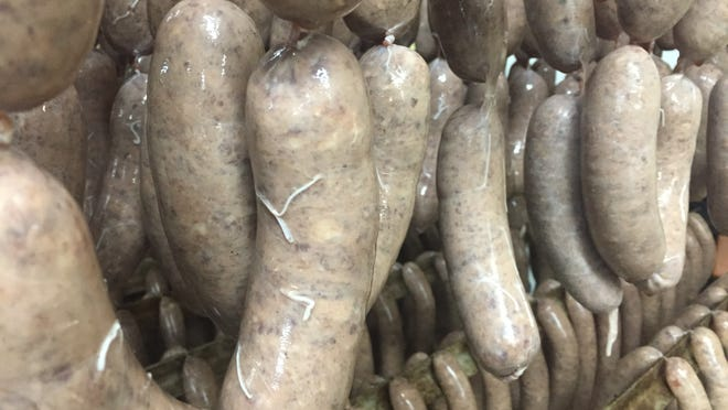 Homemade sausages hang at Thielen Meats in this Times file photo.