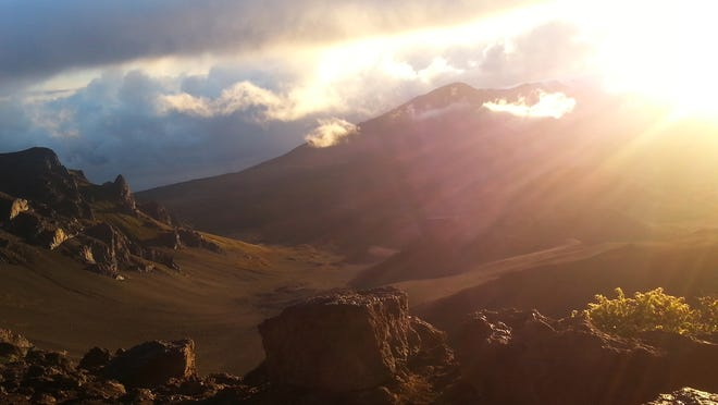 As the sun begins to creep ever so slowly toward the peak in Haleakala, the warm rays slowly began dispelling the fog that has settled in and clung to the peak since 5 a.m.