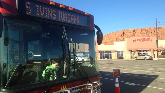 A young rider checks out the new Ivins City SunTran bus during a community tour Wednesday at the Sunset transfer station in St. George.