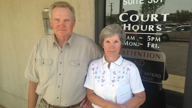 Arnold and Sandra Breitenbach speak about a Small Claims Court judgment in a dog bite case Wednesday in St. George.