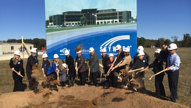 Local and state officials join members of the King family during a groundbreaking ceremony for the new Skyward world headquarters on Friday in Stevens Point.