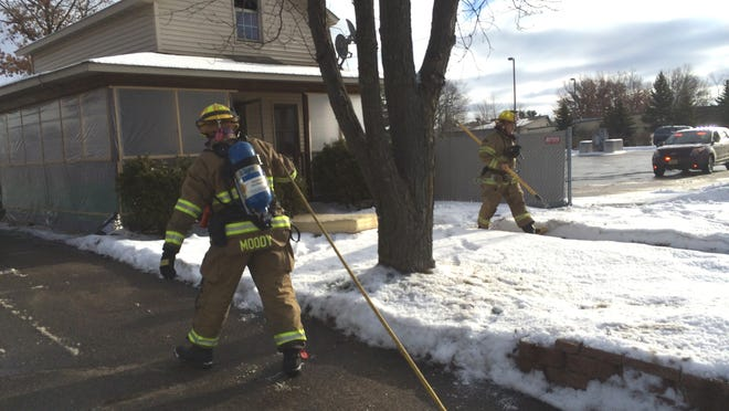 Stevens Point firefighters head into a house at 2809 Church St. Tuesday after a fire was reported in a second-story bedroom. The fire department estimated the fire caused about $5,000 in damage.