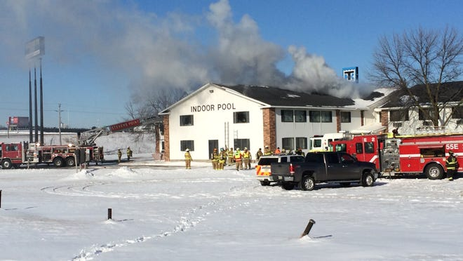 Firefighters from several local departments battle a fire Monday at the Elizabeth Inn and Convention Center in Plover.