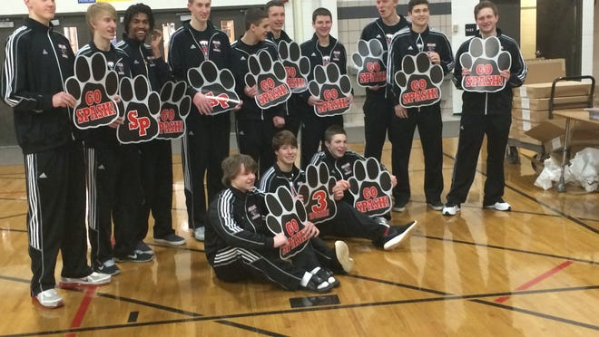 Members of the Stevens Point Area Senior High boys basketball team pose for photos with team signs Thursday before heading to Madison for the WIAA state championships.