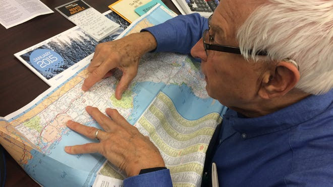 Roger Grebe points on a map to Wausau, Fla. He visited the town in October, and found out it was founded in 1889 by Wausau, Wis., businessman John Barr Glen.