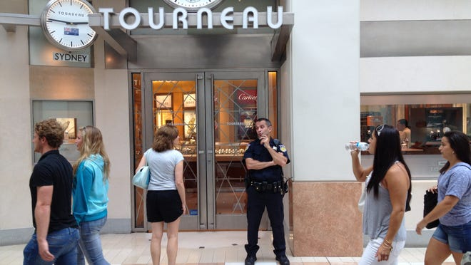 Police are investigating a brazen smash and grab robbery at the Tourneau watch store at The Westchester on Sunday.