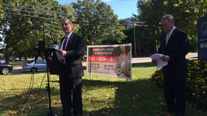Rockland County District Attorney Thomas Zugibe, at the podium, and County Executive Ed Day, announced on Monday a new approach to curtailing the area's heroin-abuse problem.