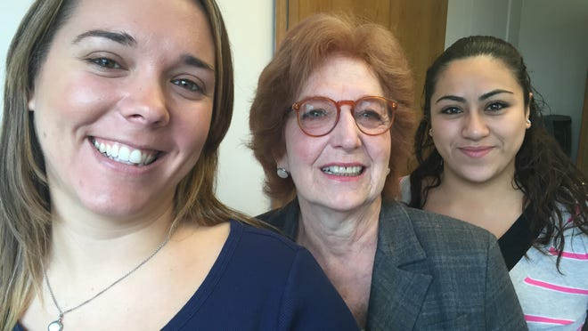 Joanne Goodman, center, executive director of CANDLE -- which stands for Community Awareness Network for a Drugfree Life and Environment -- is flanked by Annie Scott, left, assistant program director, and Viviana Tello, administrative assistant, in the group's New City offices.
