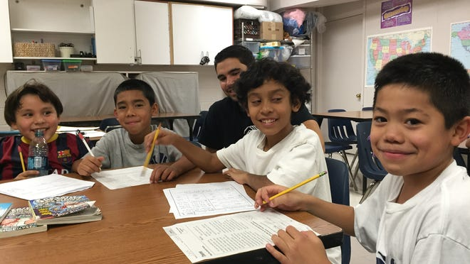 Members Diego Lopez, Joseph Duarte, Kevin Navarro and Erick Martinez did homework recently at the Boys & Girls Club of Northern Westchester in Mount Kisco. John Tunas, physical education director at the club, sat behind them.
