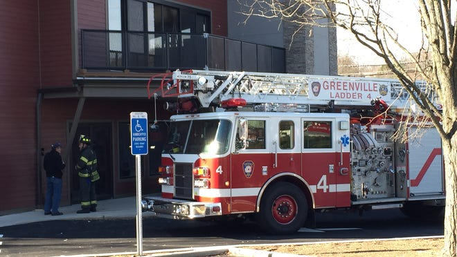 Ladder 4 of the Greenville Fire District responds to an emergency call Dec. 4, 2014, across the street from department headquarters. The truck is the subject of a complaint accusing fire officials of insurance fraud.