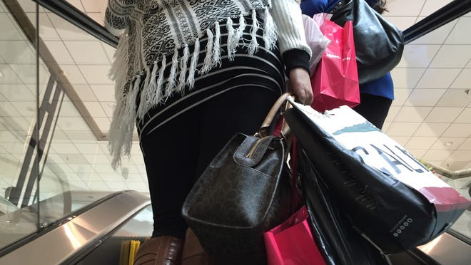 Shoppers carry bags Wednesday at the Galleria mall in White Plains. The Galleria saw more than 500 shoplifting cases since 2013, but violent crimes were nearly nonexistent.