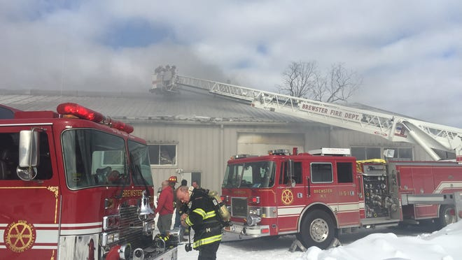 Firefighters battled a fire Tuesday afternoon at a storage building at a Brewster farm.