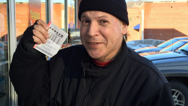 Rico Elias buys a Powerball ticket in White Plains on Wednesday for the game's $500 million drawing.