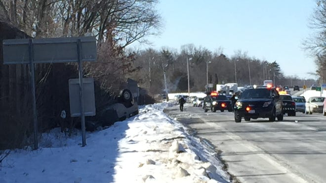 Clarkstown police respond Wednesday to an overturned car on eastbound Route 59 in West Nyack. Two lanes are closed.