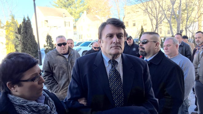 Putnam sheriff investigator Pat Castaldo enters the Putnam County courthouse where he was arraigned on a felony charge of filing a false instrument.
