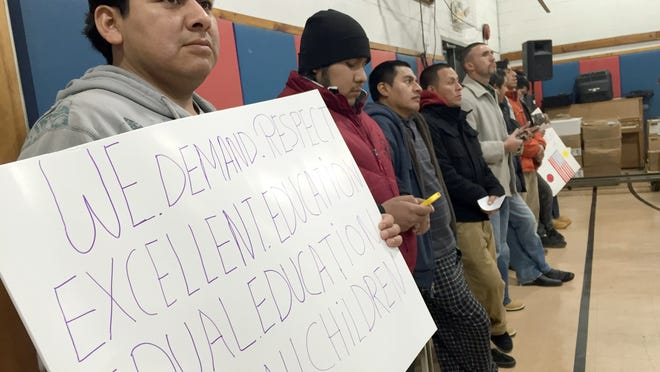 People protest school board decisions at a November East Ramapo school board meeting.