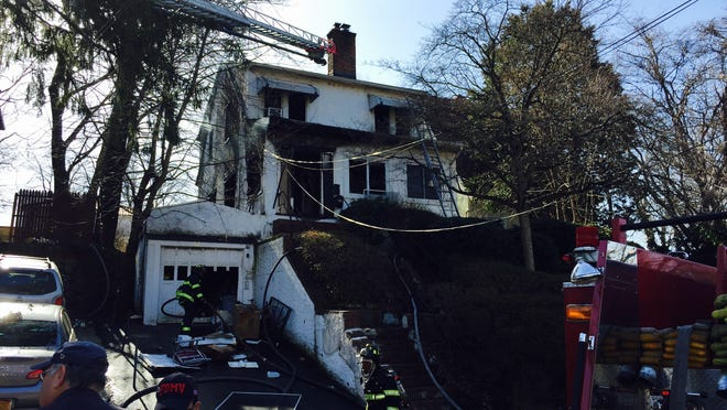 A fire heavily damaged a two-and-a-half story house at 36 Darwood Place in Mount Vernon Sunday morning.