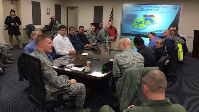Dover Air Force Base commander Col. Mike Grismer briefs contractors on base operations and reviews the construction timeline Friday for the base's $98.3 million runway refurbishment project, which begins Monday.