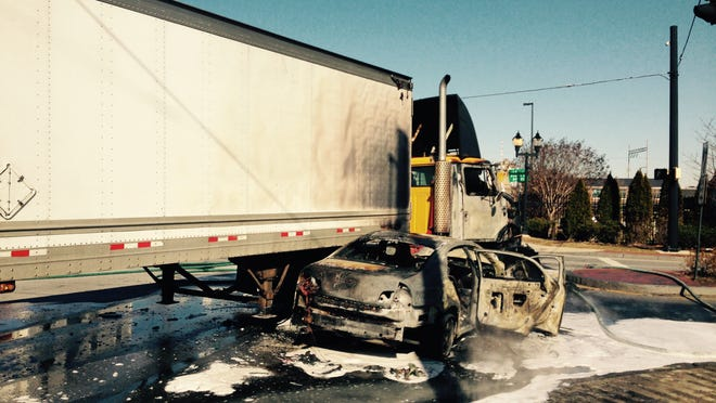 The fiery crash of a tractor-trailer and car in Wilmington has A and South Walnut streets closed to traffic.