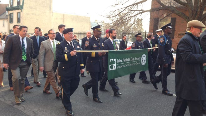 Bagpipers led a parade up King Street to the Doubletree Hotel Tuesday morning for the St. Patrick's Day Society's 22nd Annual St. Patrick's Day Communion Mass & Breakfast.
