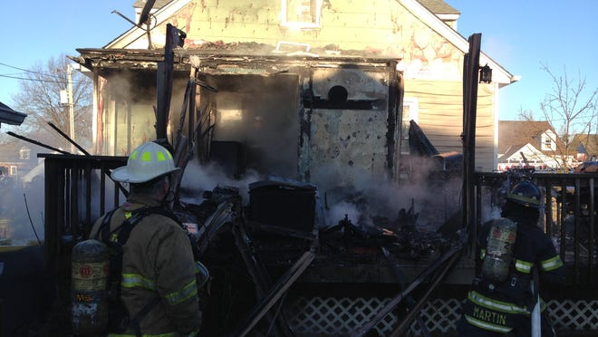 Crews battle a fire Sunday morning in the unit block of Harding Ave.