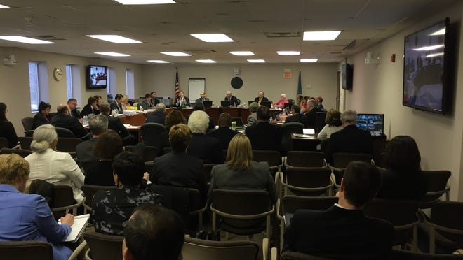 Delaware Public Service Commission members take up the Exelon-PHI/Delmarva Power merger in Dover on Tuesday.