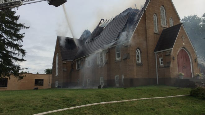 Firefighters work to extinguish the fire at the Rudolph Moravian Church on Tuesday.