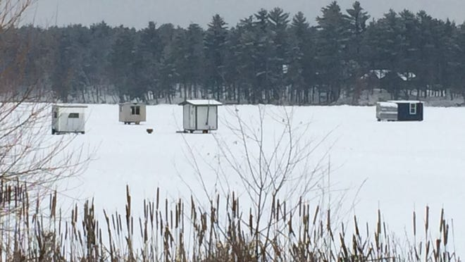 Ice fishing shanties sit on Nepco Lake Tuesday near the Nepco Lake Park. On Sunday, two vehicles broke through the ice near the shore at the park.