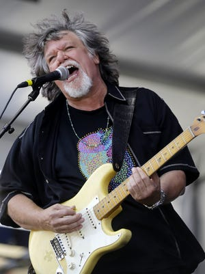 Dave Malone of the Radiators plays with the band Sunday at the New Orleans Jazz and Heritage Festival in New Orleans.
