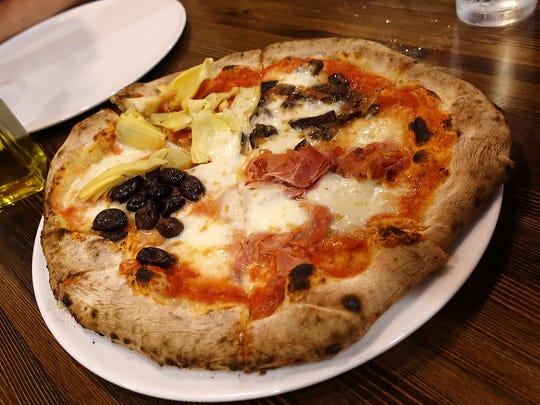 Pizza capricciosa with San Marzano tomatoes, mozzarella,
