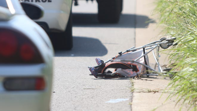 A woman and her baby were seriously injured after they were struck by a car on Dover Road on Aug. 29, 2016. This photo won first place for Spot News Photography in the state AP awards.