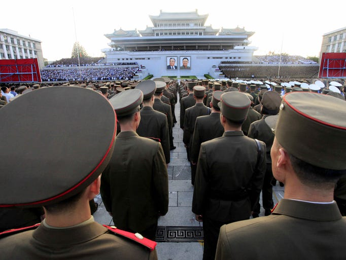 Military personnel stand during a rally at Kim Il Sung