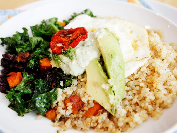 Honey and Salt's quinoa bowl with an egg over easy,