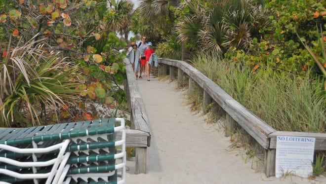 A family heads to the beach at Lori Wilson Park in Cocoa Beach.