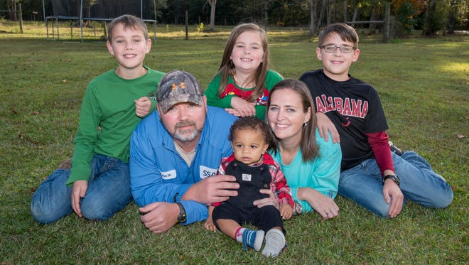 Clockwise from left, Westen Holland, 10; Morgan Holland, 7; Coleman Holland, 12; Jennifer Holland; Korbin Holland, 1; and Eric Holland pose for a photo on Monday, Nov. 20, 2017, at their home in Jay. Korbin officially became part of the Holland family when his adoption was finalized Friday, Nov. 17. 2017.