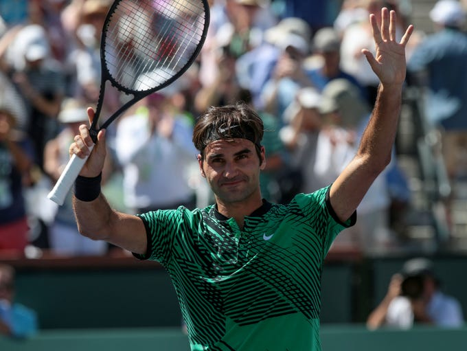 Roger Federer, of Switzerland, wave to the crowd after