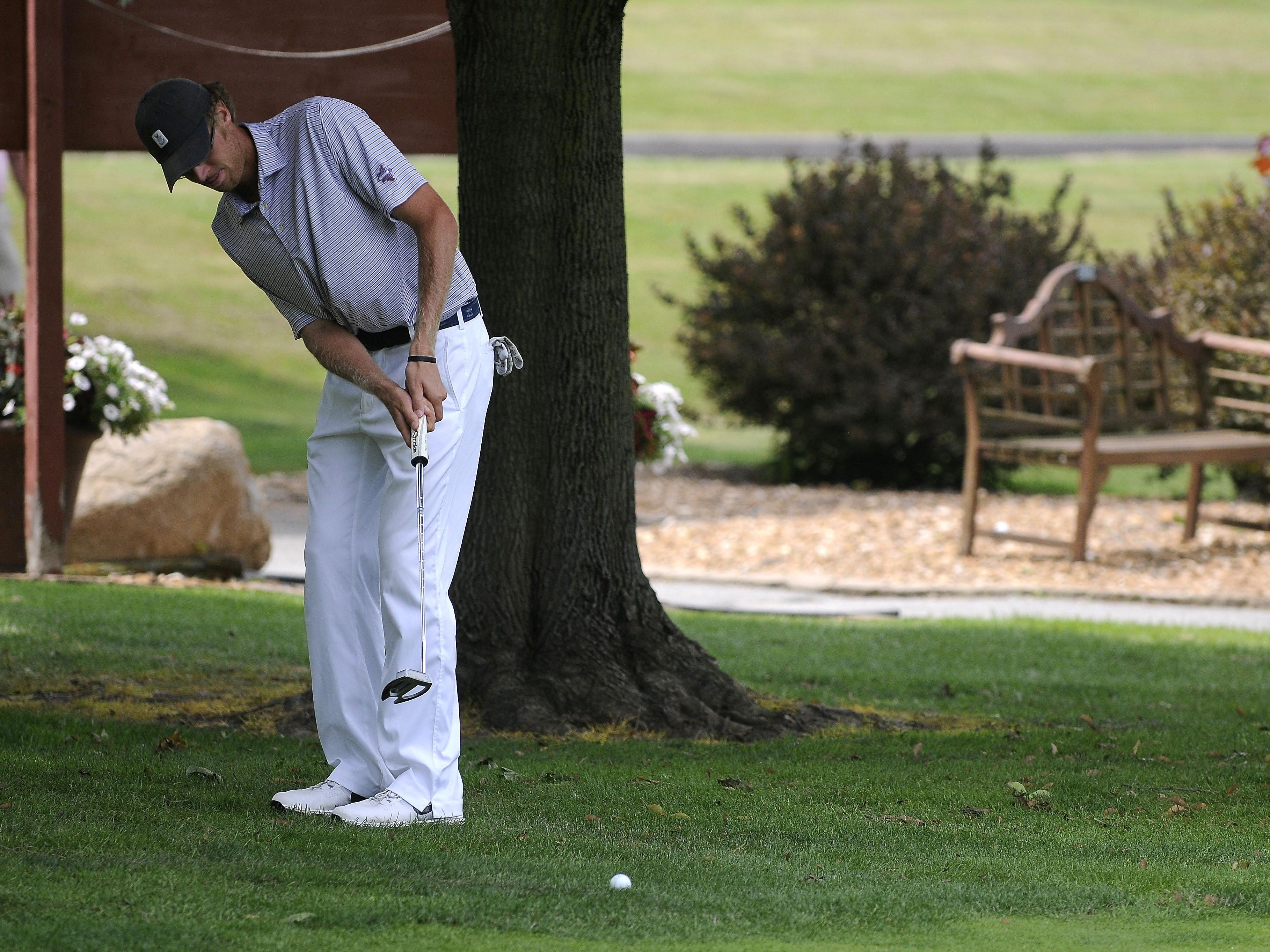 Patrick Cansfield putts from the rough onto the 18th green Friday, July 10 during the Port Huron Elks 2015 Men's Invitational in Port Huron Township.