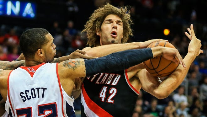 Portland Trail Blazers center Robin Lopez (42) battles for a rebound in the first quarter at Philips Arena.