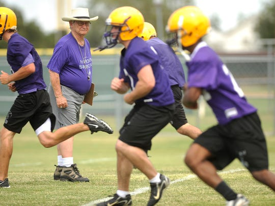 Former Hardin-Simmons coach Jimmie Keeling watches as players run drills during practice on Thursday, Aug. 13, 2009, at the HSU practice fields.