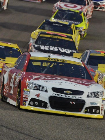 Kevin Harvick (4) couldn't pass Kyle Busch, front right,