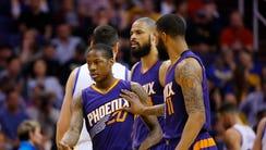 Phoenix Suns forward Markieff Morris (11) pushes guard