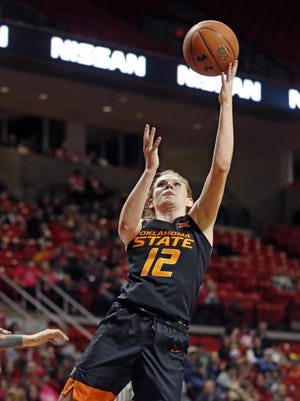 Oklahoma State's Vivian Gray (12) goes up for a shot during a February 2019 game at United Supermarkets Arena. Gray, the Big 12's second-leading scorer each of the past two years, is joining Texas Tech as a graduate transfer, according to a report Friday.