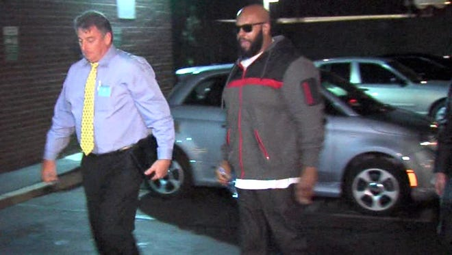 Marion 'Suge' Knight walking into Los Angeles County Sheriffs department on Jan. 30, for questioning in connection with a hit-and-run incident that left one man dead and another injured.