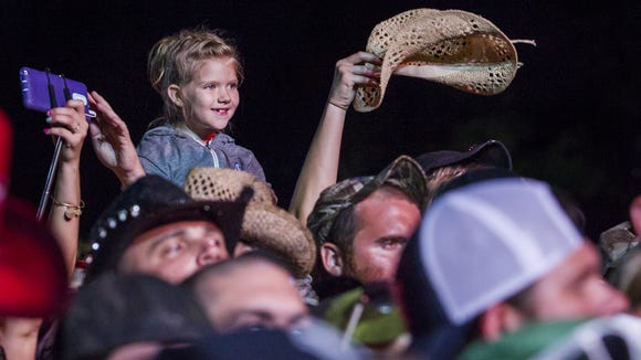 A young fan gets a boost above the crowd as Blake Shelton performs at the Big Barrel Country Music Festival on Friday night.