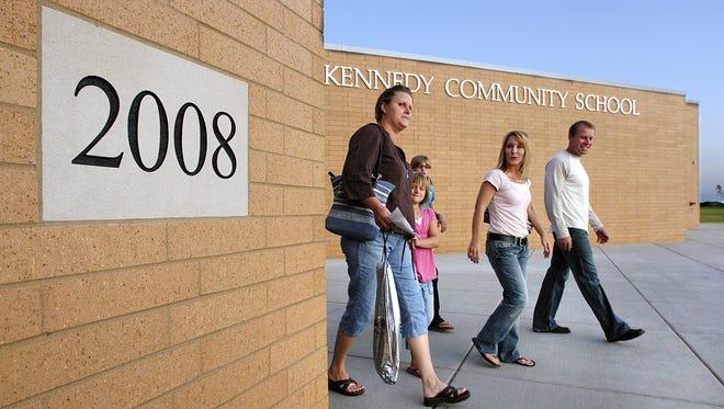 Columnist Derek Larson proposes one of three magnet high schools be build next to Kennedy Community School in St. Joseph.